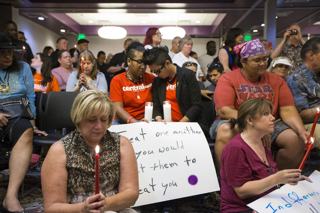 People join for a prayer during a candle light vigil honoring the victims of the Orlando mass shooting at the The Gay and Lesbian Community Center of Southern Nevada on Sunday, June 12, 2016, in L ...