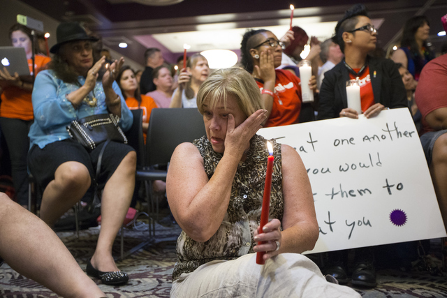 NVDEMS Chairwoman Roberta Lange wipes a tear during a candle light vigil honoring the victims of the Orlando mass shooting at the The Gay and Lesbian Community Center of Southern Nevada on Sunday, ...