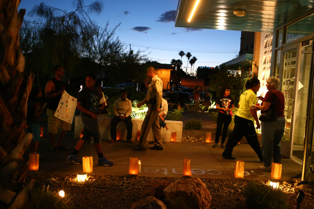 Audience members come to give support during the candle light vigil honoring victims of the Orlando mass shooting at the The Gay and Lesbian Community Center of Southern Nevada on Sunday, June 12, ...