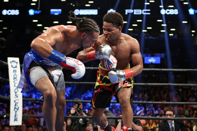 Keith Thurman, left, backpedals against Shawn Porter during their WBA Welterweight title fight at the Barclays Center in Brooklyn borough of New York on Saturday, June 25, 2016. Thurman won via un ...