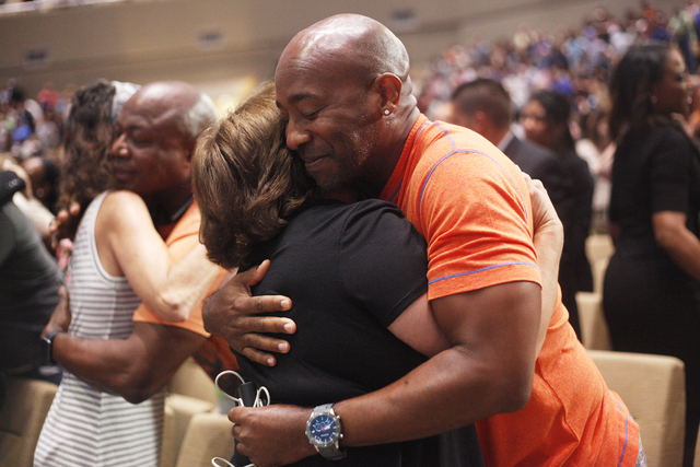 Carolina Asencio, left, hugs Eddie Jumper after a service to honor victims of the Orlando nightclub shooting at the First Baptist Orlando Church in Orlando, Florida on Tuesday, June 14, 2016. (Rac ...