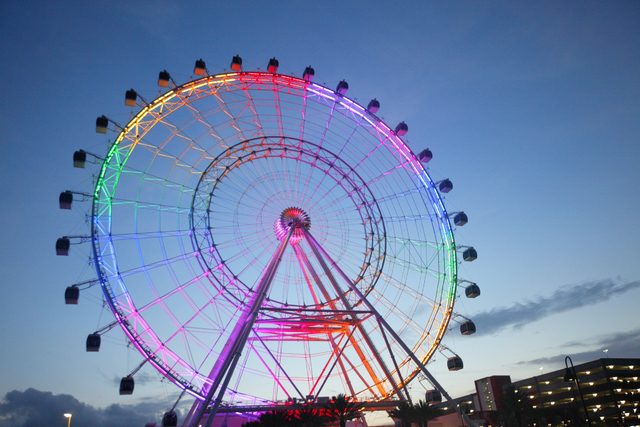 The Eye of Orlando ride is seen onThursday, June 16, 2016, in Orlando, Fla. It is lit rainbow in honor of those killed at the gay nightclub Pulse on Sunday. (Rachel Aston/Las Vegas Review-Journal) ...