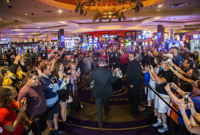 Howie Borrow, a cup keeper with the Hockey Hall of Fame, walks into the lobby of the Hard Rock Hotel with Stanley Cup Monday, June 20, 2016, in Las Vegas. Benjamin Hager/Las Vegas Review-Journal