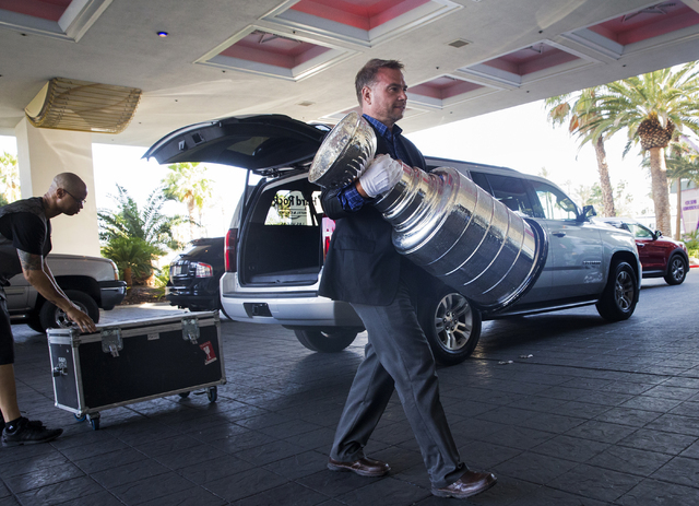 Howie Borrow, a cup keeper with the Hockey Hall of Fame, carries the Stanley Cup into the lobby of the Hard Rock Hotel Monday, June 20, 2016, in Las Vegas. Benjamin Hager/Las Vegas Review-Journal