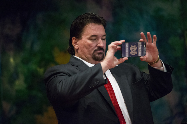 Nevada Republican Party Chairman Michael McDonald uses his phone during a campaign rally for Republican presidential candidate Donald Trump at the Treasure Island hotel-casino on Saturday, June 18 ...