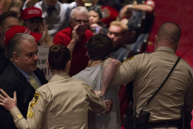 Michael Steven Sandford is escorted out during a campaign rally by Republican presidential candidate Donald Trump at the Treasure Island hotel-casino on Saturday, June 18, 2016, in Las Vegas. Erik ...