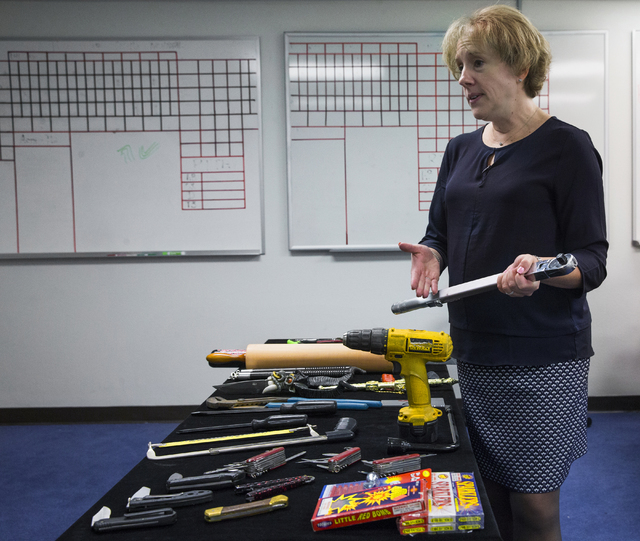 Lorie Dankers, a spokeswoman for the Transportation Security Administration, points out a restricted tool a passenger recently attempted to carry on a flight at McCarran International Airport on M ...