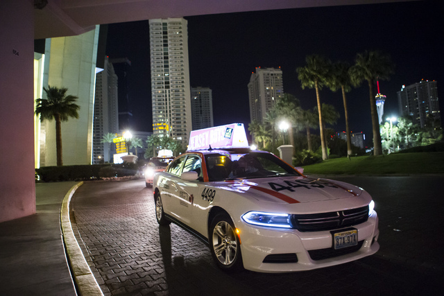 Desert Cab taxi driver Andrew Gnatovich lines up to pick up passengers at the Westgate hotel-casino in Las Vegas on Wednesday, May 4, 2016. (Chase Stevens/Las Vegas Review-Journal) Follow @cssteve ...