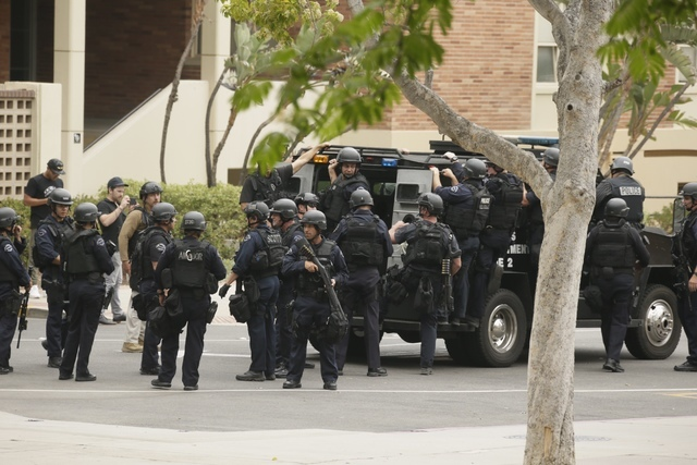 Police officers respond to the scene of a fatal shooting at the University of California, Los Angeles, Wednesday, June 1, 2016, in Los Angeles. (Irfan Khan/Los Angeles Times via AP)