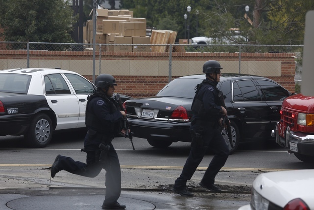 Police officers respond to the scene of a fatal shooting at the University of California, Los Angeles, Wednesday, June 1, 2016, in Los Angeles. (Genaro Molina/Los Angeles Times via AP)