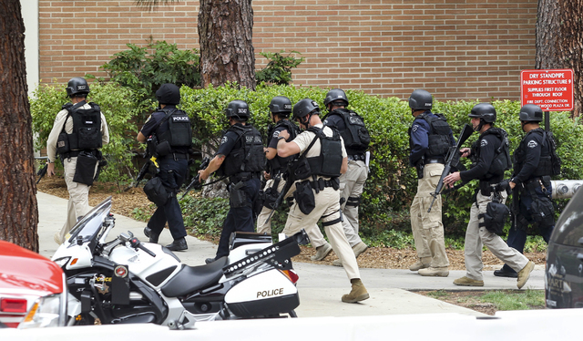 Police officers work at the scene of a fatal shooting at the University of California, Los Angeles, Wednesday, June 1, 2016, in Los Angeles. (Ringo H.W. Chiu/AP)