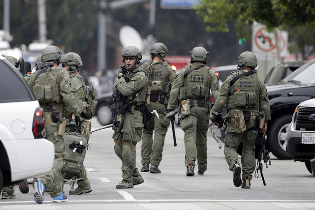 An FBI SWAT team arrives at the scene of a fatal shooting at the University of California, Los Angeles, Wednesday, June 1, 2016, in Los Angeles. (Nick Ut/AP)