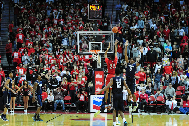 UNLV guard Patrick McCaw (22) hits the game tying field goal at the as time expires in regulation time during their NCAA college basketball game against UNR at the Thomas & Mack Center in Las  ...