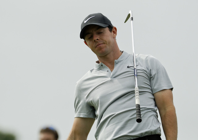 Rory McIlroy, of Northern Ireland, reacts to his tee shot on the sixth hole during the first round of the U.S. Open golf championship at Oakmont Country Club on Thursday, June 16, 2016, in Oakmont ...