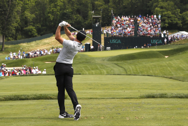Rory McIlroy, of Northern Ireland, watches his tee shot on the sixth hole during the first round of the U.S. Open golf championship at Oakmont Country Club on Thursday, June 16, 2016, in Oakmont,  ...