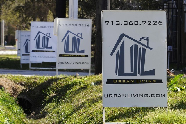 For Sale signs are stacked up outside a new complex of townhouses in Houston, Feb. 16, 2016. (Pat Sullivan/AP)