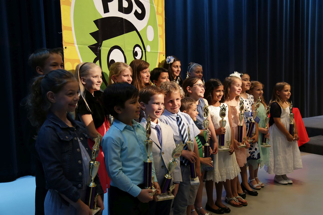 Students line up and smile during the Vegas PBS KIDS Writers Contest awards ceremony. Approximately 1,225 entries were received from students in grades kindergarten through fifth. Special to View