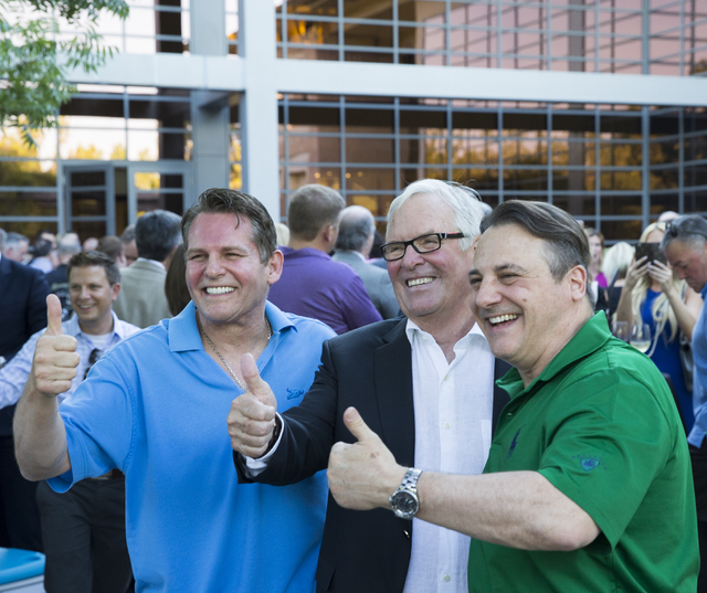 Joe Maloof, from left, Bill Foley and Gavin Maloof, pose for a photo at a party to celebrate Las Vegas' new NHL expansion team, June 23, 2016, in Las Vegas. Foley teamed with the Maloof family to  ...