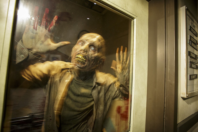"A ""walker"" is seen inside Universal Studio Hollywood's ""The Walking Dead"" attraction. (Courtesy Universal Studios Hollywood/David Sprague)"