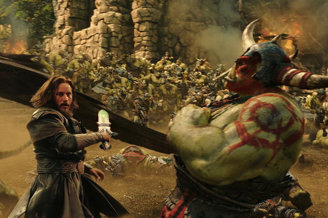 """Commander Anduin Lothar (TRAVIS FIMMEL) defends himself against an orc from The Horde in """"Warcraft."""" From Legendary Pictures and Universal Pictures comes""""Warcraft."""" Photo Credit: Legendary Picture ..."""