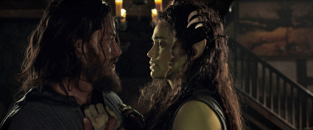 """Commander Anduin Lothar (TRAVIS FIMMEL) grows closer to half-orc Garona (PAULA PATTON) in Legendary Pictures and Universal Pictures' """"Warcraft."""" (Legendary Pictures, Universal Pictures and ILM)"""