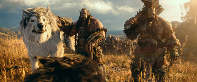 """(L to R) Orc chieftain Durotan (TOBY KEBBELL) leads his Frostwolf Clan alongside his second-in-command, Orgrim (ROB KAZINSKY), in Legendary Pictures and Universal Pictures' """"Warcraft."""" (Legendary  ..."""
