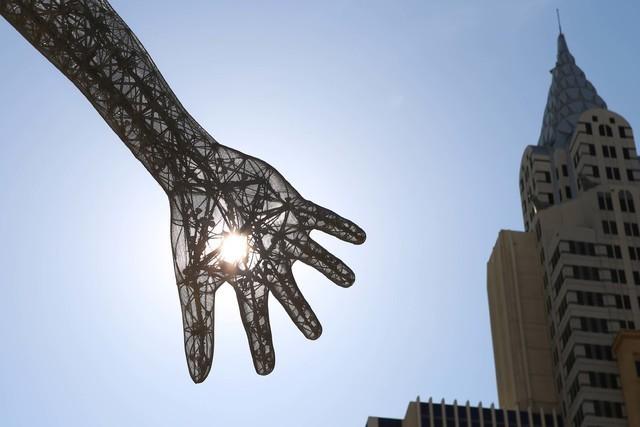 The morning sun light rays pierce through the Bliss Dance sculpture at The Park near T-Mobile Arena on the Las Vegas Strip. (Bizuayehu Tesfaye/Las Vegas Review-Journal) Follow @bizutesfaye