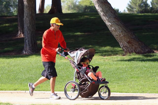 Mel Feliciano pushes his 3-year-old daughter Khaely's stroller as he runs at Sunset Park during a hot morning on Wednesday, June 1, 2016. (Bizuayehu Tesfaye/Las Vegas Review-Journal Follow @bizute ...