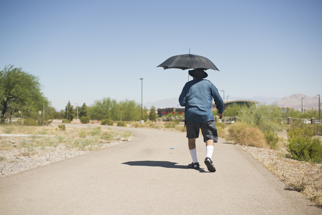 Joe Olmeda takes his daily walk along Boulder Highway in Henderson on Friday, June 17, 2016. Alameda says he tries to take a walk every day, but doesn't when it gets too hot. (Daniel Clark/Las Veg ...