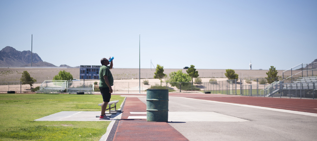 Ty Curry takes a break while working out at Foothill High School in Henderson on Monday, June 20, 2016. Curry is training for his applications to Clark County Detention Center and Nevada Highway P ...