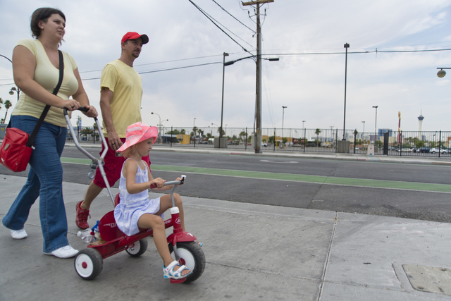 The Lehel family takes a walk in downtown Las Vegas where temperatures were expected to soar above 110 degrees on Tuesday, June 21, 2016. (Daniel Clark/Las Vegas Review-Journal Follow @DanJClarkPhoto)