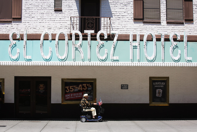 A man scoots past the El Cortez Hotel in downtown Las Vegas on Thursday, June 16, 2016. Brett Le Blanc/Las Vegas Review-Journal Follow @bleblancphoto