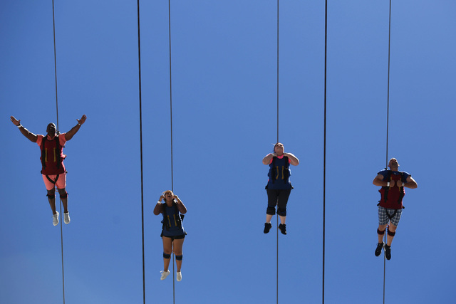 People start their zip-line journey down the Fremont Street Experience in downtown Las Vegas on Thursday, June 16, 2016. Brett Le Blanc/Las Vegas Review-Journal Follow @bleblancphoto