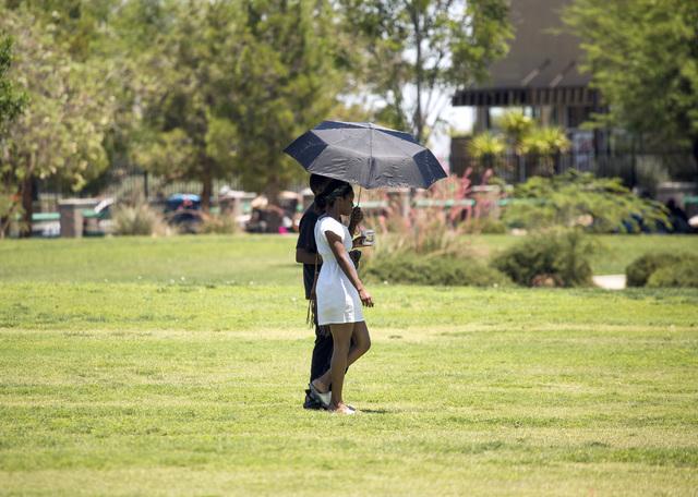 A couple walks in Molasky Family Park on Monday, June 20, 2016. Jeff Scheid/Las Vegas Review-Journal Follow @jlscheid