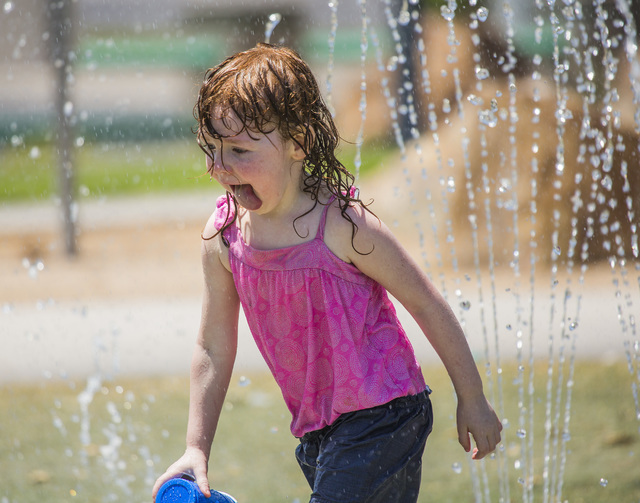 Kaitlyn Simpkins, 3, plays in a water fountain at Molasky Family Park on Monday, June 20, 2016. Jeff Scheid/Las Vegas Review-Journal Follow @jlscheid