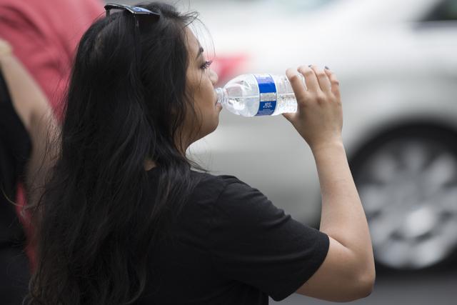 A woman drinks water near The LINQ on Tuesday, June 21, 2016, in Las Vegas. (Erik Verduzco/Las Vegas Review-Journal Follow @Erik_Verduzco)