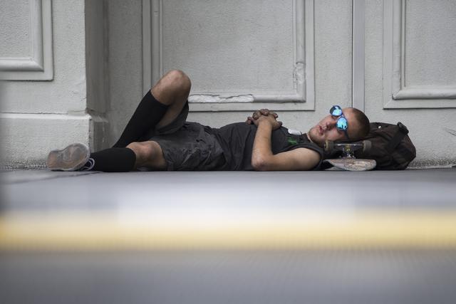 A man rests on a pedestrian overpass near The Cromwell Las Vegas hotel-casino on Tuesday, June 21, 2016, in Las Vegas. (Erik Verduzco/Las Vegas Review-Journal Follow @Erik_Verduzco)