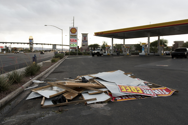 Debris from a fireworks stand which collapsed due to the storm sits in the Shell gasoline station parking lot on Blue Diamond Road at Valley View Boulevard in Las Vegas Thursday, June 30, 2016. Ja ...