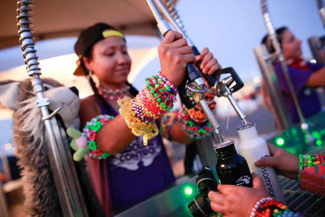 Attendees get their waters filled at the Cosmic Meadow stage at Electric Daisy Carnival at the Las Vegas Motor Speedway in Las Vegas on Sunday, June 21, 2015. (Chase Stevens/Las Vegas Review-Journ ...