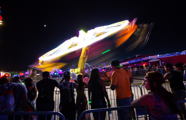 Attendees line up for a carnival ride at Electric Daisy Carnival at the Las Vegas Motor Speedway in Las Vegas on Sunday, June 21, 2015. (Chase Stevens/Las Vegas Review-Journal) Follow Chase Steven ...