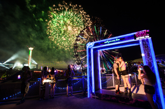 Patrick Crawley and Brittany Seidel, right, share a kiss as fireworks go off at Electric Daisy Carnival at the Las Vegas Motor Speedway in Las Vegas during the early hours of Monday, June 22, 2015 ...