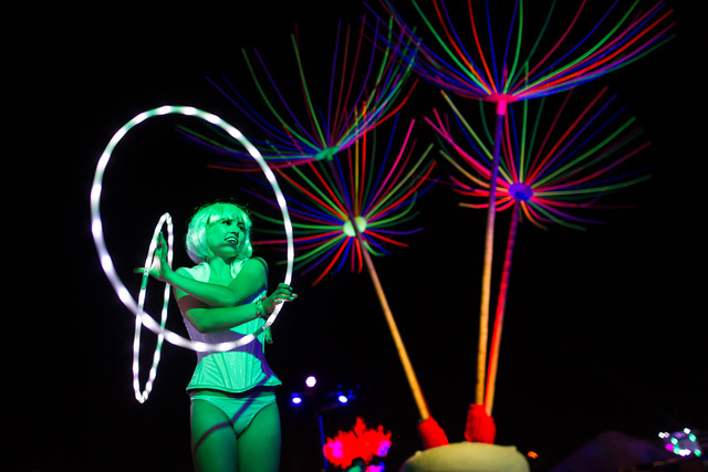 A performer hula hoops at the Dandelion Forest art installation at Electric Daisy Carnival at the Las Vegas Motor Speedway in Las Vegas during the early hours of Monday, June 22, 2015. (Chase Stev ...