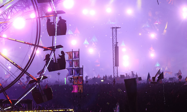 Attendees ride on the ferris wheel as the Kinetic Field stage is seen in the background at Electric Daisy Carnival at the Las Vegas Motor Speedway in Las Vegas during the early hours of Monday, Ju ...