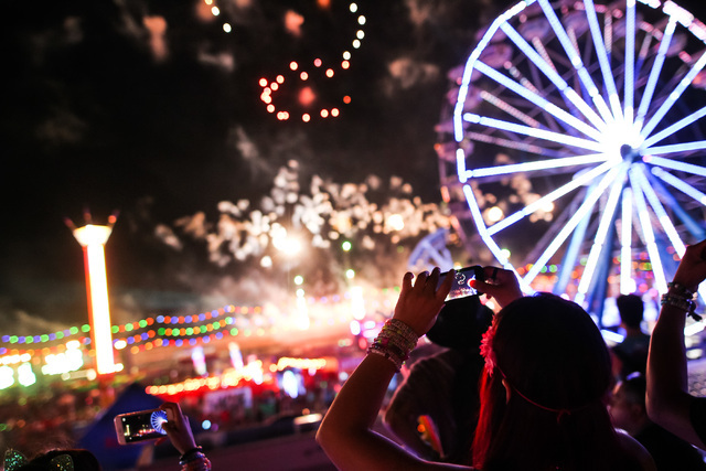 Attendees record the fireworks at Electric Daisy Carnival at the Las Vegas Motor Speedway in Las Vegas during the early hours of Monday, June 22, 2015. (Chase Stevens/Las Vegas Review-Journal) Fol ...