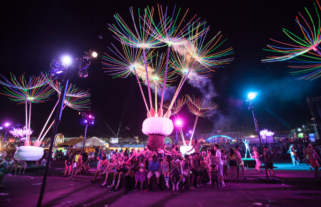 Attendees relax at the Dandelion Forest art installation at Electric Daisy Carnival at the Las Vegas Motor Speedway in Las Vegas during the early hours of Monday, June 22, 2015. (Chase Stevens/Las ...