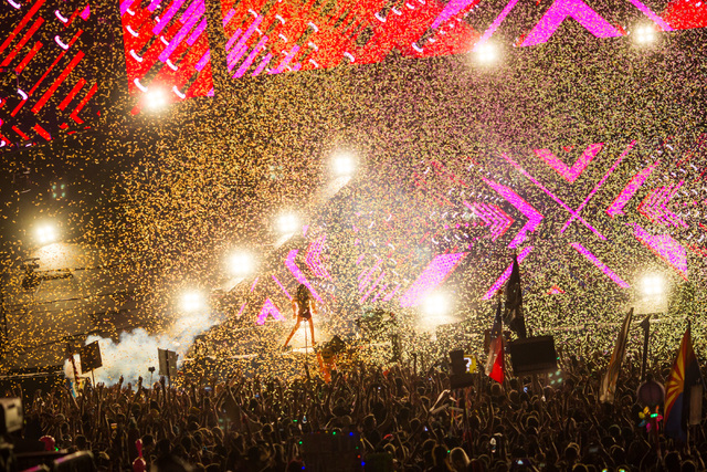 Confetti flies in the air as Seven Lions performs on the Cosmic Meadow stage at Electric Daisy Carnival at the Las Vegas Motor Speedway in Las Vegas during the early hours of Monday, June 22, 2015 ...