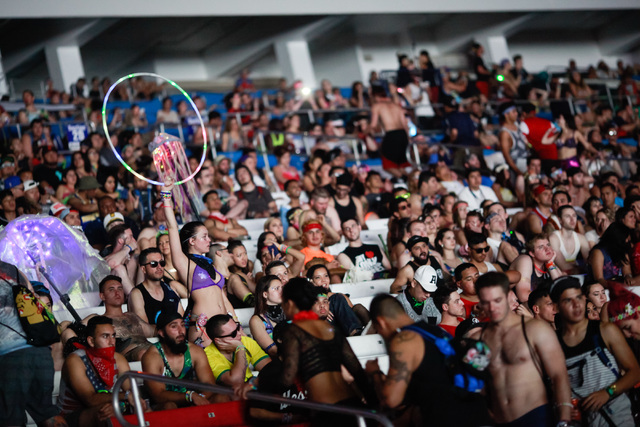 Attendees relax in the grandstands at Electric Daisy Carnival at the Las Vegas Motor Speedway in Las Vegas during the early hours of Monday, June 22, 2015. (Chase Stevens/Las Vegas Review-Journal  ...