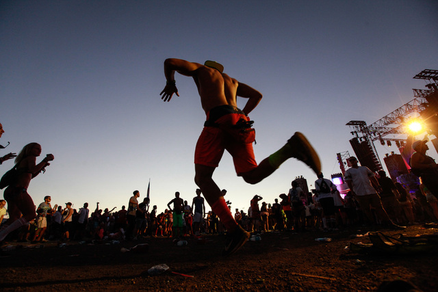 People dance to music at the Waste Land stage as the sun rises at Electric Daisy Carnival at the Las Vegas Motor Speedway in Las Vegas on Monday, June 22, 2015. (Chase Stevens/Las Vegas Review-Jou ...