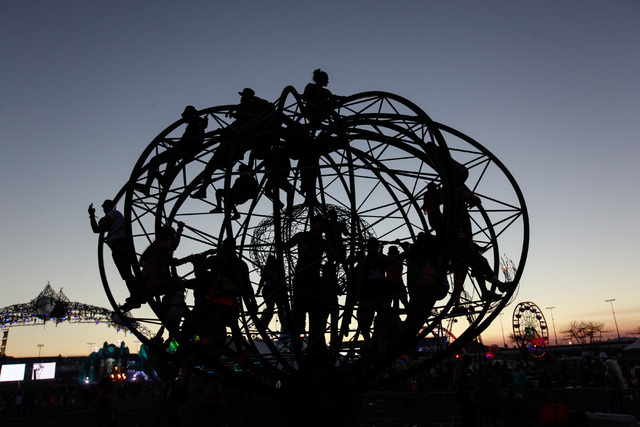 Attendees interact with the ePod art installation as the sun rises at Electric Daisy Carnival at the Las Vegas Motor Speedway in Las Vegas on Monday, June 22, 2015. (Chase Stevens/Las Vegas Review ...