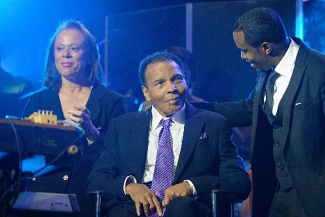 Muhammad Ali, his wife, Lonnie, and recording artist Sean Combs appear at the Keep Memory Alive Foundation's fundraiser Feb. 18, 2013, at the MGM Grand Garden arena. (Review-Journal file photo)